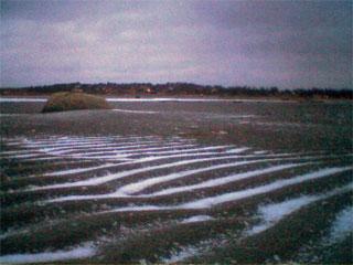 Sand och snö i förening vid Rågelund